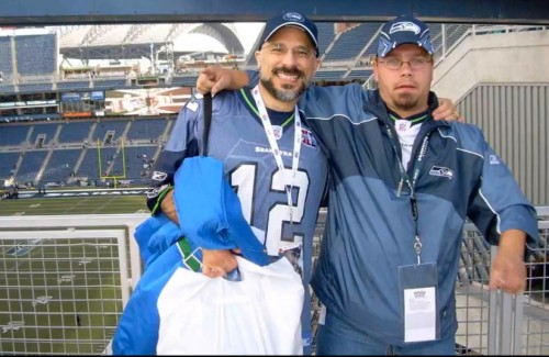 Last Kiss contributor Mike Pascale Artist-Writer (left) with Game Buzz co-creator Jason M Davies at a Seahawks game.