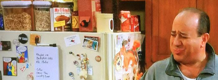 "Louis Mustillo who plays ""Vince"" on MIKE & MOLLY reacts with joy that the Last Kiss fridge magnets (Far left) are back on the show."