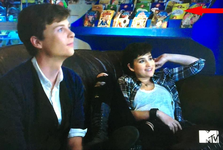 A whole row of Last Kiss comics can be seen in this scene from TV show SCREAM. Featured in the foreground are actors John Karna (Noah Foster) and Bex Taylor-Klaus (Audrey Jensen.)