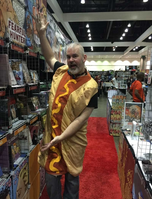 Zan Christensen hot dogs it at his Northwest Press booth.