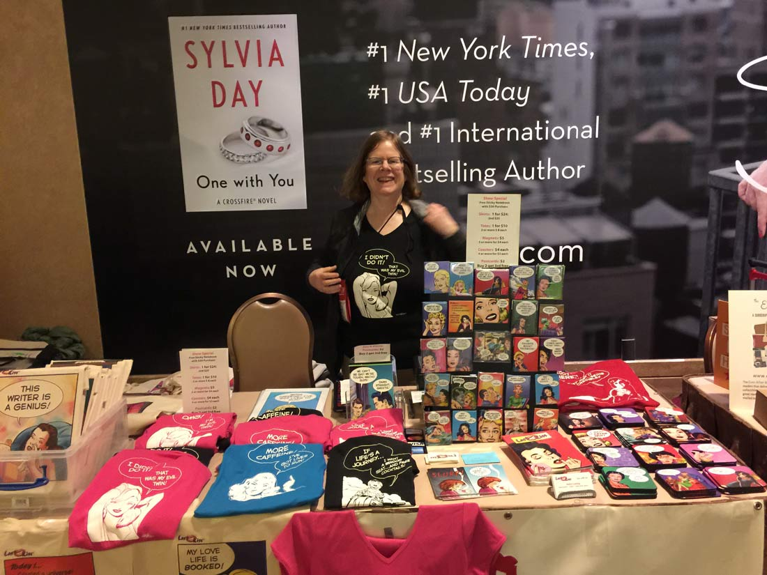 My wife (Shelagh) was sometimes mistaken for best-selling author Sylvia Day because of the huge poster behind our table on the last day.